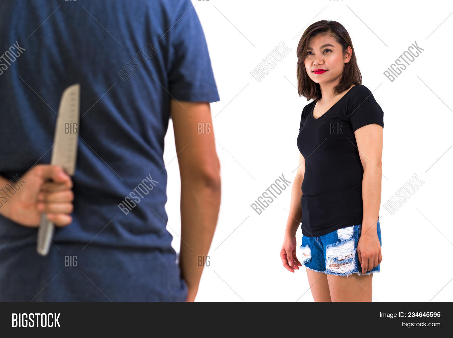 Man holding woman from behind