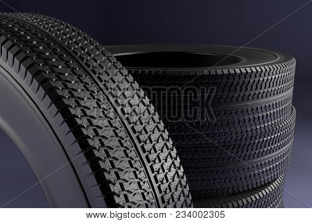 New Winter Tires With A Modern Tread On The Black Background. 3d High Resolution Image.
