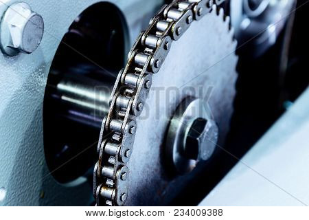 Large Sprocket Of Mechanical Chain Transmission. Abstract Industrial Background.