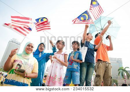 Kuala Lumpur, Malaysia : 16th September 2011 A Group Of Young Malaysian Celebrating The Malaysia Day