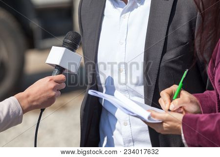 Media Interview. Press Conference. Broadcasting Journalism. Microphone.