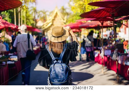 Young Woman Traveler Traveling To Wat Phra Singh Temple. This Temple Contains Supreme Examples Of La