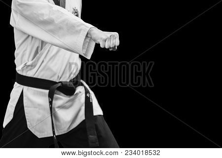 Taekwondo Traditional Korean Male Fighter Punch Fist Isolated On Black