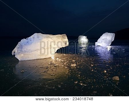 Arctic Ice. A Large Piece Of Natural Ice On A Green Blue Flat Ice Of Frozen Lake, Water Bubbles Text