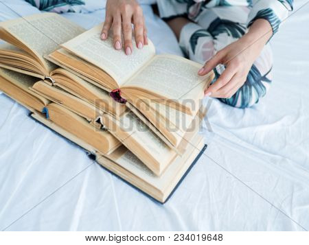 Education And People Concept - Hands Of Woman Above A Lot Of Books.