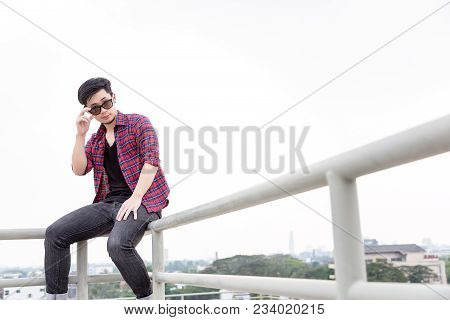 Portrait Charming Handsome Young Asian Guy. Attractive Man Is Looking Something. Cool Asia Guy Wears