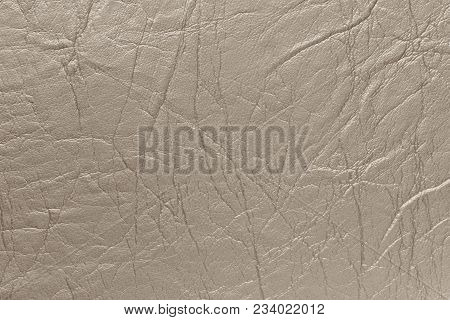 Surface Imitation Leather With Creases And Wrinkles In Beige Color As Background Or Texture.