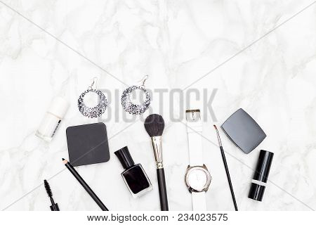 Female Cosmetics And Accessories Are Black And White On A Marble Background. Copy Space