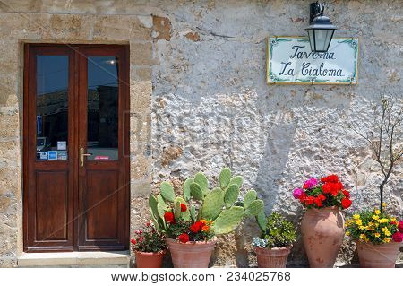 Marzamemi, Italy - May 14, 2004: Sicily Island, An Old Tavern In The Village Center