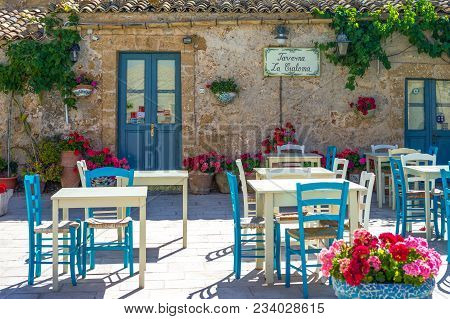 Marzamemi, Italy - June 7, 2012: Sicily Island,  An Old Tavern In The Main Square Of The Village