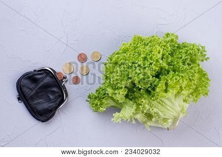 Fresh Lettuce, Purse And Coins. Small Leather Wallet With Coins And Organic Lettuce On Light Texture