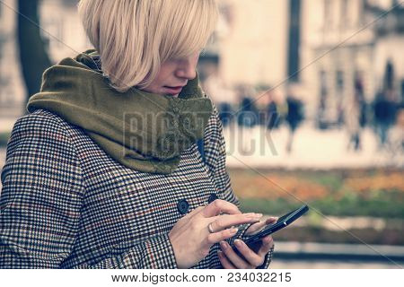 Current And Future Trends In Remote Work. Young Busines Woman Working Remotely And Using Mobile Phon