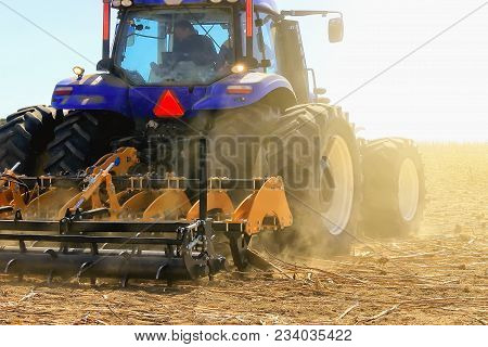 Modern Combine Harvester Works In The Field. Sowing And Harvesting.