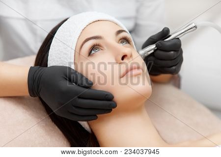 Beautiful Woman Getting Radio Frequency Lifting On Her Face. Professional Beautician Doing Anti-wrin