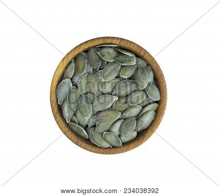 Pumpkin Seeds Isolated On White Background. Top View. Pumpkin Seeds In A Bowl Isolated On White Back