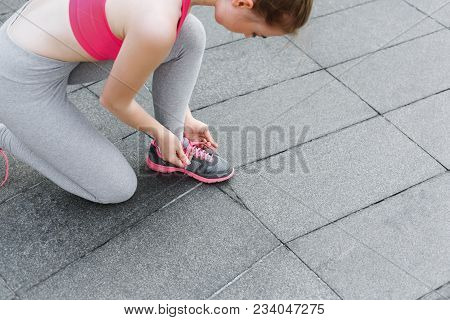 Unrecognizable Woman Tying Shoelaces On Sneakers Before Running, Getting Ready For Jogging In The Ci
