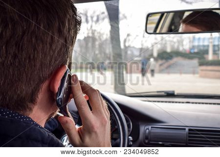 Businessman Ignoring Safety And Texting Smartphone While Driving