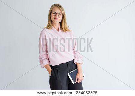 Smiling Modern Business Lady With Tablet Wearing Stylish Clothes And Eyeglasses Looking At Camera. C