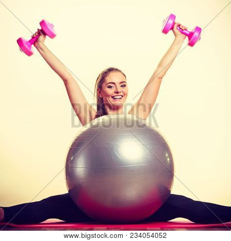 Exercise Sport Fitness Health Concept. Fit Girl Exercising. Attractive Female Warming Up With Ball A