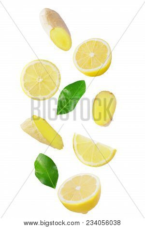 Isolated Flying Citrius. Fresh Falling Lemon And Ginger Isolated On White Background With Clipping P