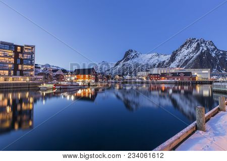 Night View Over The Harbor And City Center Of Svolvaer, Lofoten, Norway With Reflections Of City Lig