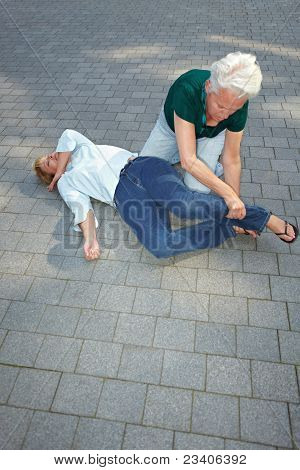Senior Woman Using Recovery Position