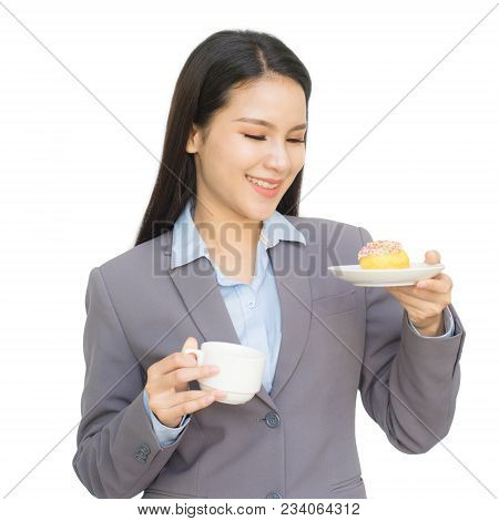 Portrait Of Business Woman With Cup Of Tea Or Coffee And One Hand Holding Donut Isolated On White Ba