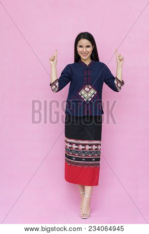 Portrait Beautiful Asian Girl In Traditional Thai Dress Isolated On Pink Background.  Cotton Dress