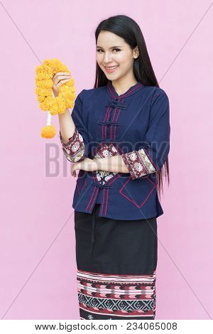 Portrait Of Asian Young Girl In Traditional Thai Dress And Holding  Marigold Garland Isolated On Pin