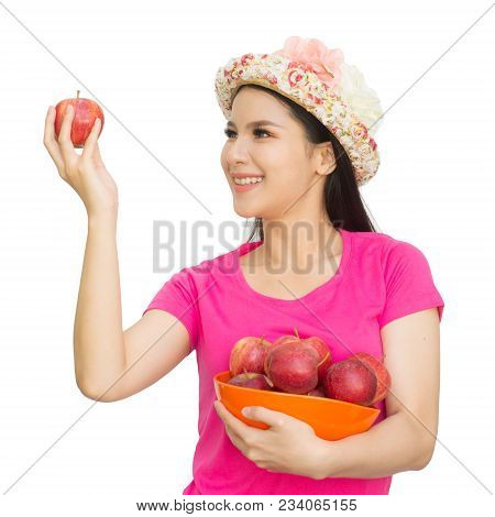 Portrait Of Lovely Young Woman Holding A Fresh Ripe Apple In Bowl And Smiling Isolated On White Back
