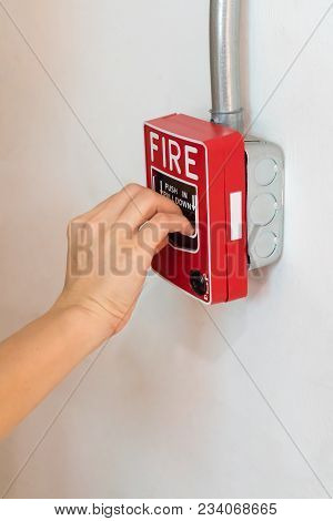 Hand Pushing The Push In Pull Down Switch Fire