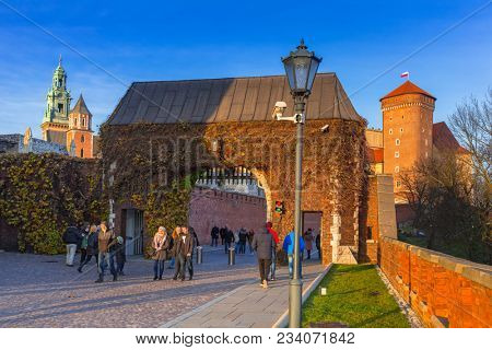 Krakow, Poland - November 12, 2017:  Gate to the Royal Wawel Castle in Krakow at sunset, Poland. The castle located in Krakow, being one of the largest in Poland