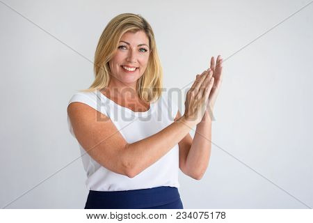 Smiling Mature Caucasian Woman In Casual Wear Applauding. Experienced Housewife Approving Houseclean
