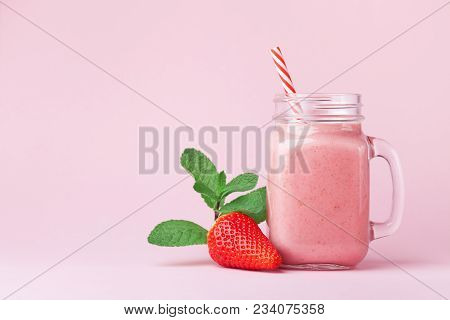 Strawberry Smoothie Or Milkshake In Mason Jar Decorated Mint On Pink Table. Healthy Food For Breakfa