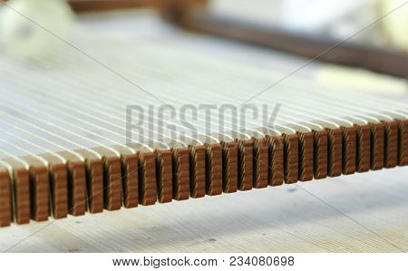 Weaving On A Loom Frame. The Threads In The Frame For Weaving.