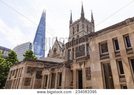 12th Century Gothic Style Southwark Cathedral, In The Background The Shard Skyscraper, London, Unite