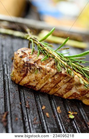 Grilled Tuna Steaks On Grill With Rosemary