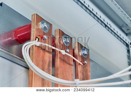 Electrical Wires Are Connected To Copper Busbars. Busbars Are Fixed To The Circuit Board Through Red