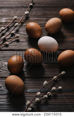 Chiken Eggs And Catkins On Wooden Table, Easter Concept