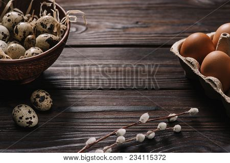 Chicken Eggs, Quail Eggs And Catkins On Wooden Table, Easter Concept