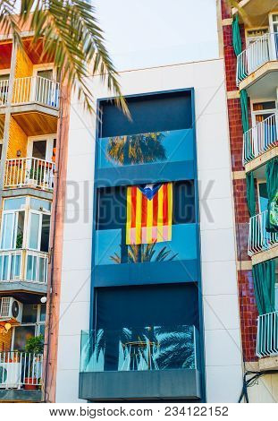 The Nationalist Flag Of Catalonia On The Building In Badalona. Spain