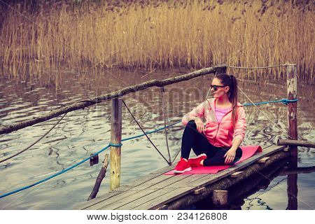 Sport And Lifestyle Concept. Young Sports Woman Female Jogger Taking A Break From Running Workout, R