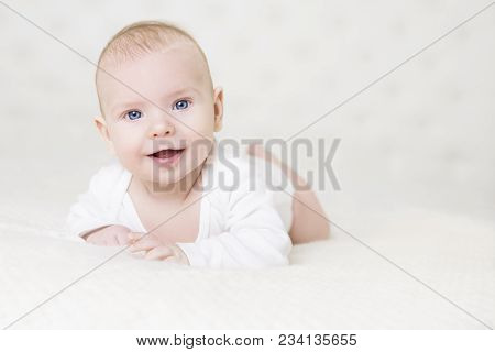 Baby Crawling On White Carpet, Happy Little Kid Portrait, Smiling Infant Child Boy In Bed