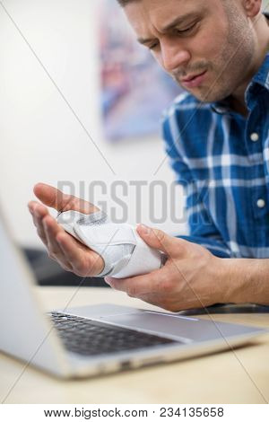 Businessman Using Laptop Suffering From Repetitive Strain Injury (RSI) poster