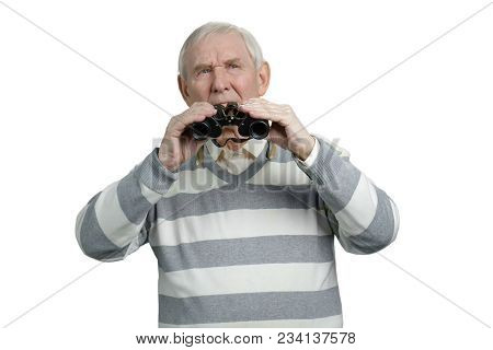 Senior Man Holding Binoculars. Portrait Of Thoughtful Pensive Man With Binoculars Observing Location