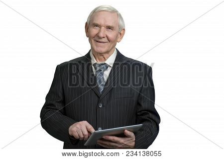 Smiling Senior Business Man Tapping Tablet. Portrait Of Old Man In Suit In White Isolated Background