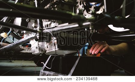 Car Mechanic Drains Engine Oil From Car Engine