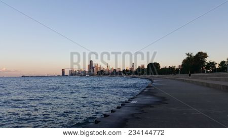 Chicago Lake Front Walkway Along The Shoreline Of Lake Michigan With The Chicago Skyline Cityscape I