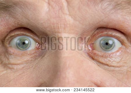Excited Widely Opened Grandpa Eyes. Shocked Eyes, Macro View.