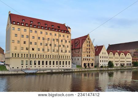 Gdansk, Poland. Old Buildings On The Bank Of The River In A Sunny Summer Evening